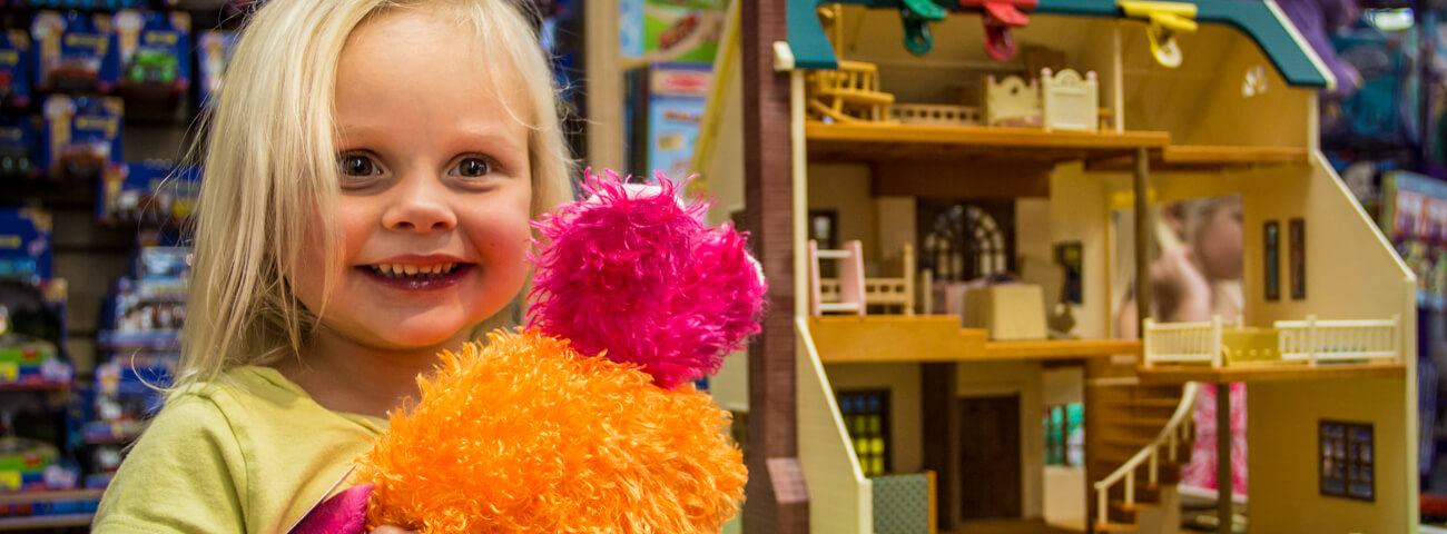 Child shops at toy store in Mount Pleasant, SC