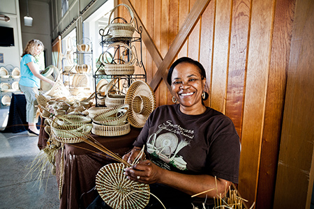 Women weaving Sweetgrass Baskets at Sweetgrass Pavilion